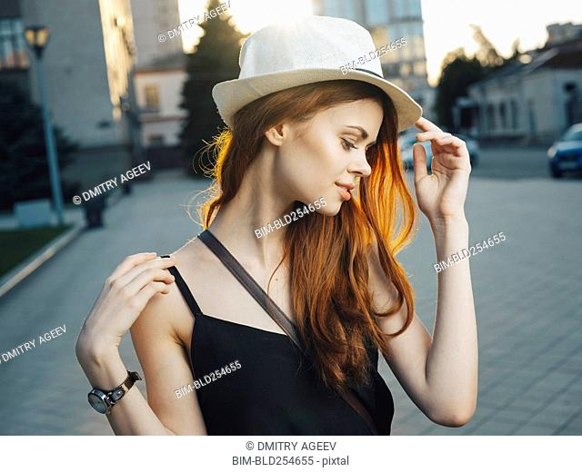 Smiling Caucasian woman in city