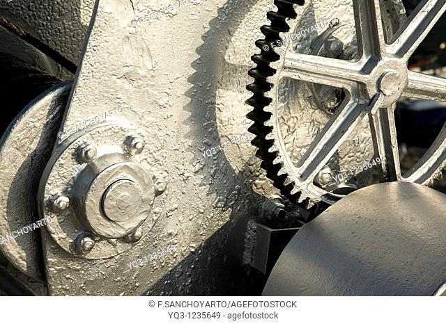 Gears of the old crane, port of Castro Urdiales, Cantabria, Spain