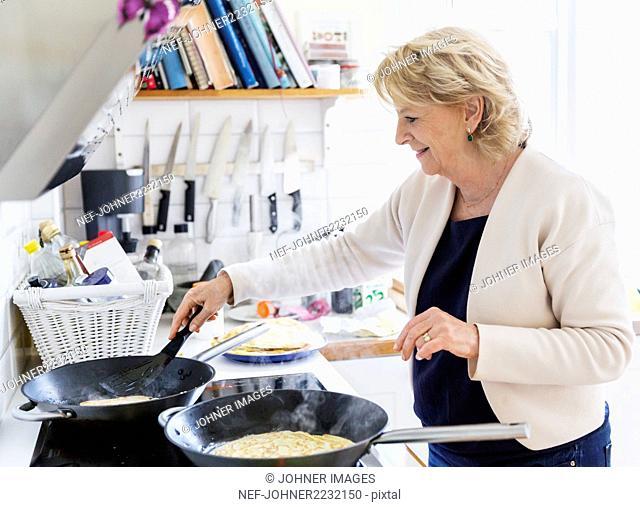 Woman preparing pancakes