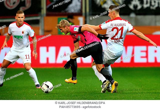 Augsburg's Dominik Kohr (R) and Per Ciljan Skjelbred from Hertha BSC vie for the ball during the German Bundesliga soccer match between FC Augsburg - Hertha BSC...