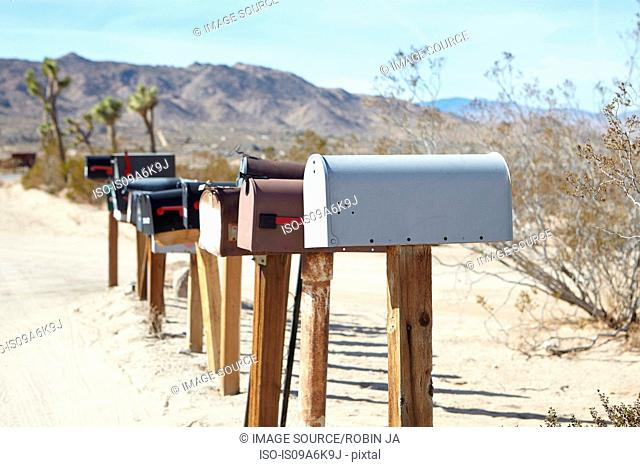 Mailboxes in dry rural landscape
