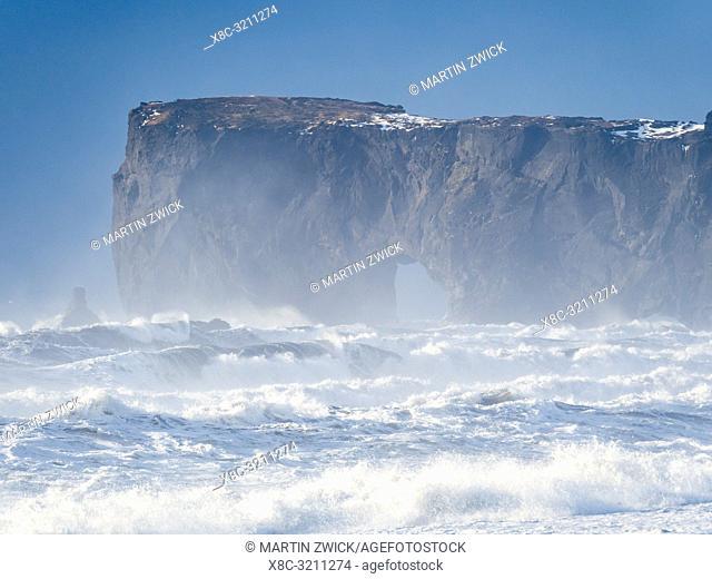 The coast of the north atlantic near Vik y Myrdal during winter. Black volcanic beach Reynisfjara, view towards Dyrholaey