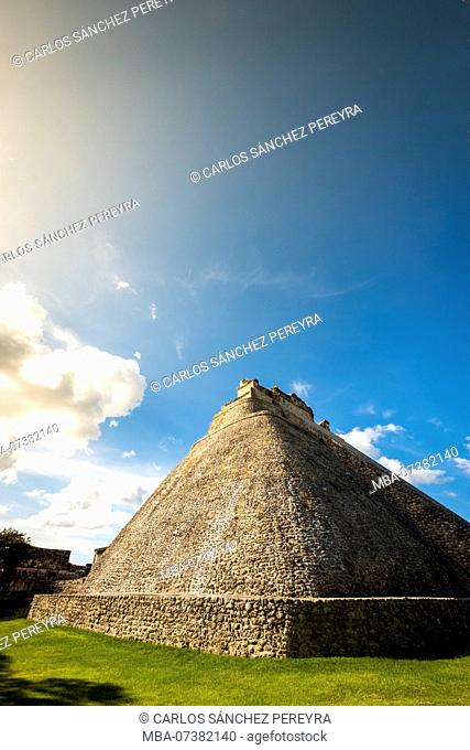 Uxmal, Yucatan, Mexico - October 13, 2017: The Pyramid of the Magician (Pirámide del Mago) towering in the Maya City of Uxmal, Mexico