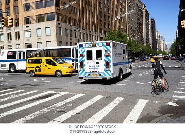 lenox hill hospital ambulance on call cutting through stopped traffic New York City USA