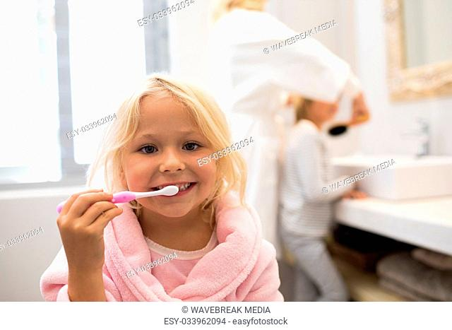 674ffefb42 Bathrobe brushing teeth bathroom Stock Photos and Images