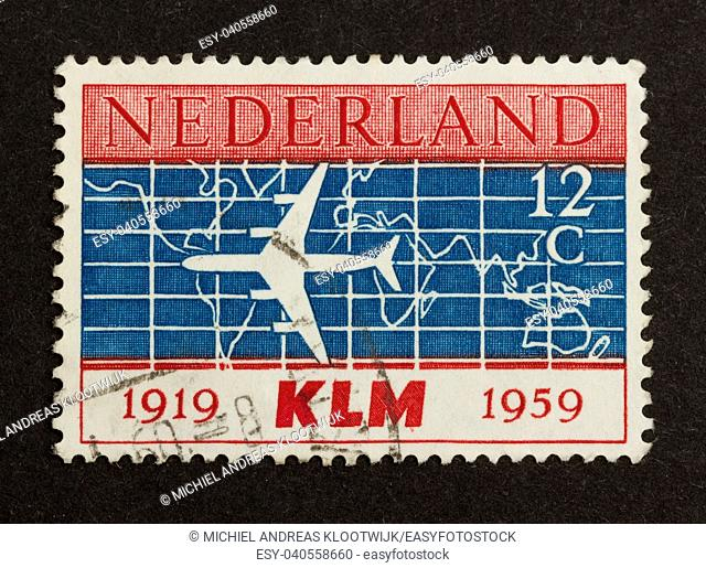 HOLLAND - CIRCA 1950: Stamp printed in the Netherlands shows a jet of the dutch airliner KLM, circa 1950