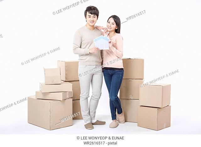 Young smiling couple with packages