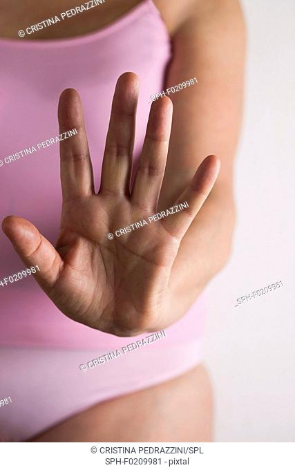 Woman holding hand out towards camera