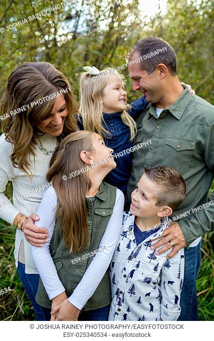 Lifestyle portrait of five people in a family along the banks of the McKenzie River in Oregon
