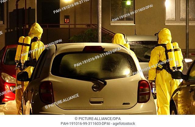 15 October 2019, Saxony, Haldensleben: Firefighters are in protective suits. Two employees of the parcel service Hermes in Haldensleben in Saxony-Anhalt have...
