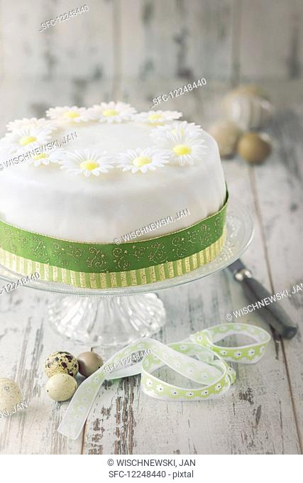 Easter cake with white icing flowers