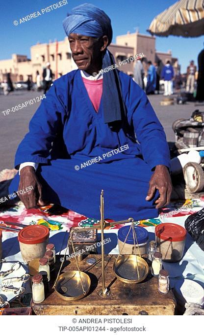Morocco, Marrakech. Jemaa el Fna Square, spices salesman