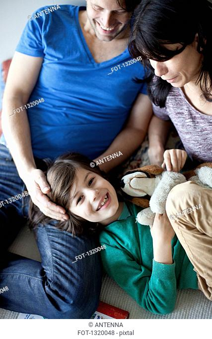 Boy having fun with parents