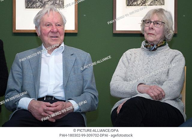 02 March 2018, Germany, Dresden: The couple Guenther and Annemarie Gercken from Hamburg who is friends with the artist sits in the exhibition 'Maniera Baselitz...