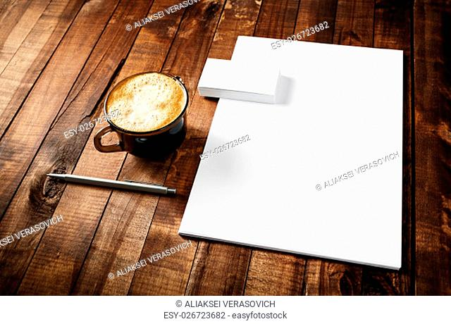 Mock-up for ID. Blank paperwork stationery set. ID template on vintage wooden table background. Blank letterhead, business cards, coffee cup and pen