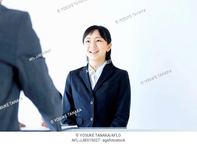 Japanese young woman undergoing job interview