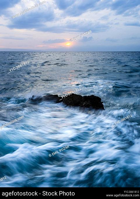Stormy sunset sea waves