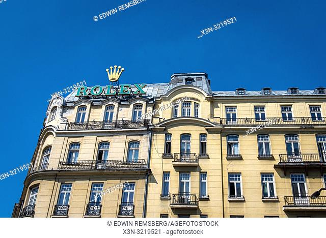A giant Rolex sign hangs atop a building, an indication of western culture and commercialization spreading to the former communist block, Warsaw