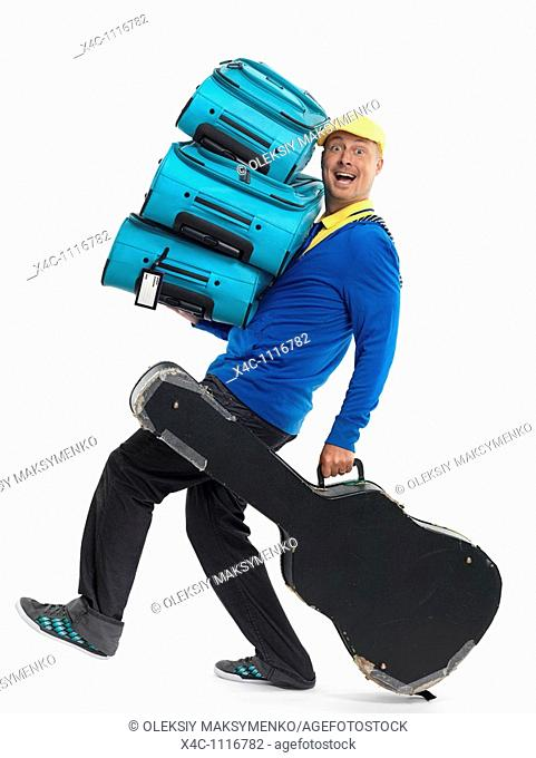 Smiling young man carrying a load of luggage  Isolated on white background