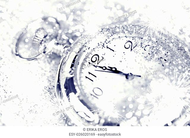New Year's at midnight - Old watch with stars, snowflakes and holiday lights