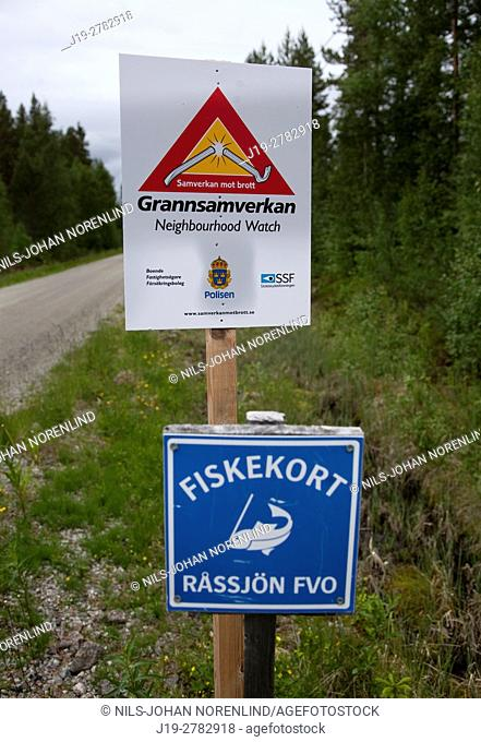 Neighbourhood watch and fishing sign, countryside of northern Sweden