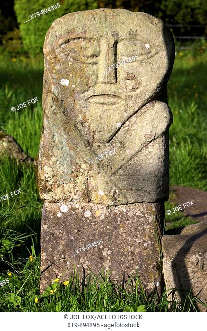 boa island bilateral carved stone figure often called the janus stone based on a celtic diety or goddess caldragh cemetary county fermanagh northern ireland uk