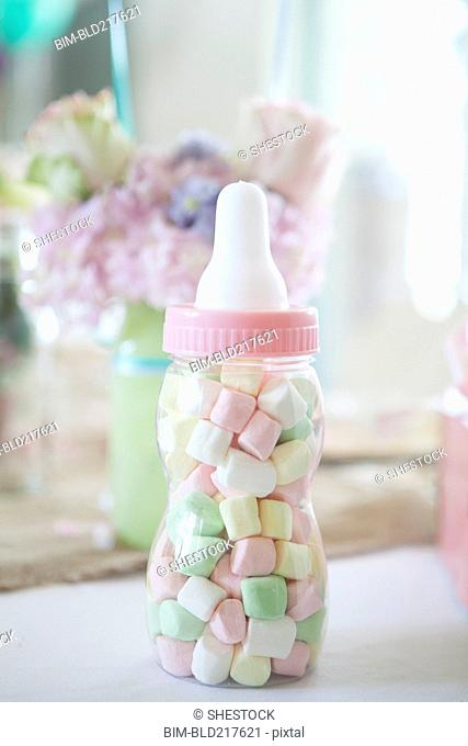 Close up of candy baby bottle gift