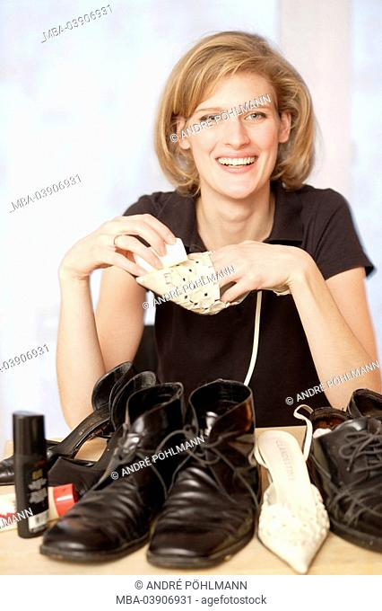 Woman, young, cheerfully, shoes, cleaning, sponge, semi-portrait