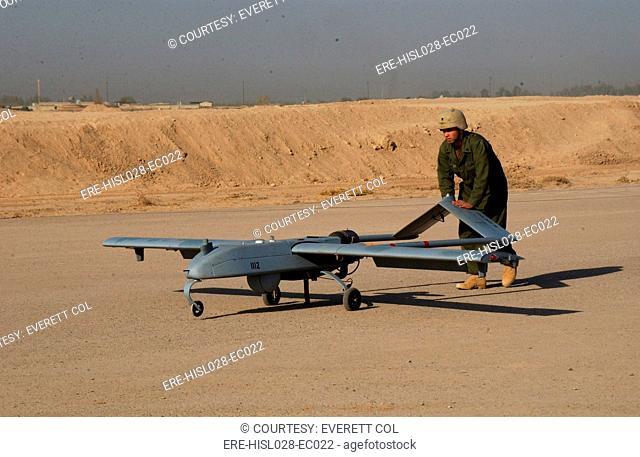 US Army soldier with an intelligence battalion recovers an Unmanned Aerial Vehicle following a mission over the Baqubah Iraq area. Sept. 22 2004