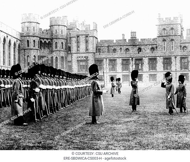 The 1st Battalion Welsh Guards recieve a salute from the Prince of Wales during an inspection at Windsor Castle on Saint David's