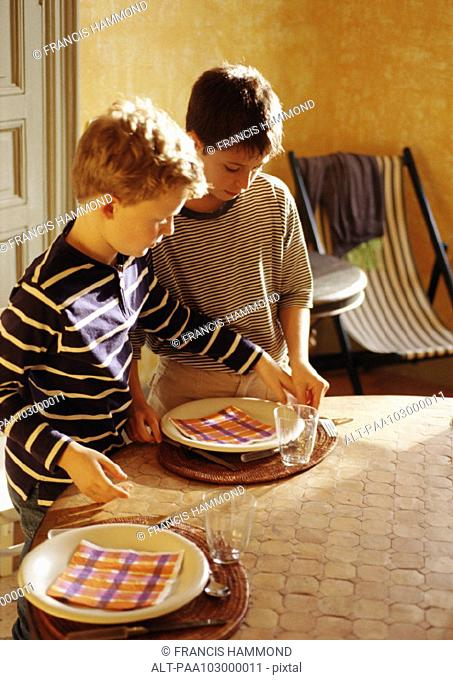 Children setting table