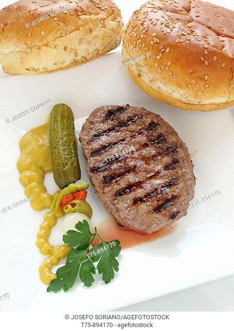 Hamburger with salt, mustard and sesame bread