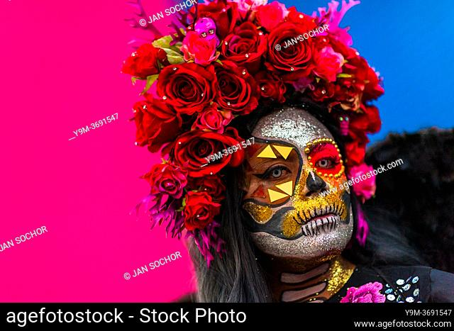 A young Mexican woman, dressed as La Catrina, a Mexican pop culture icon representing the Death, takes part in the Day of the Dead celebrations in Oaxaca