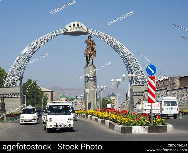 Statue commemorating Alymbek Datka and arch at the city border at Pamirskaya street, starting point of Pamir Highway. City Osh in the Fergana Valley close to...