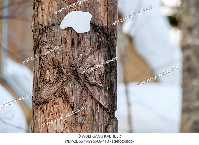 View of a carved wooden Ainu pole depicting an owl in Ainu Kotan, which is a small Ainu village in Akankohan in Akan National Park, Hokkaido, Japan