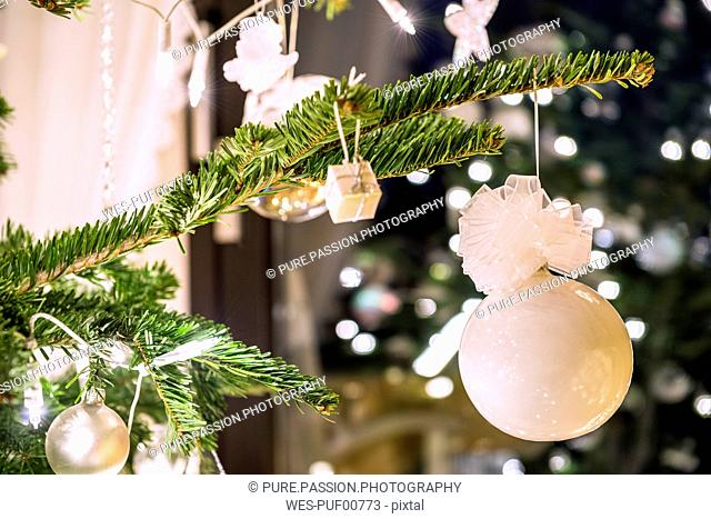 Fir branch with white Christmas decoration