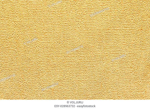 old yellow textured paper on the wall