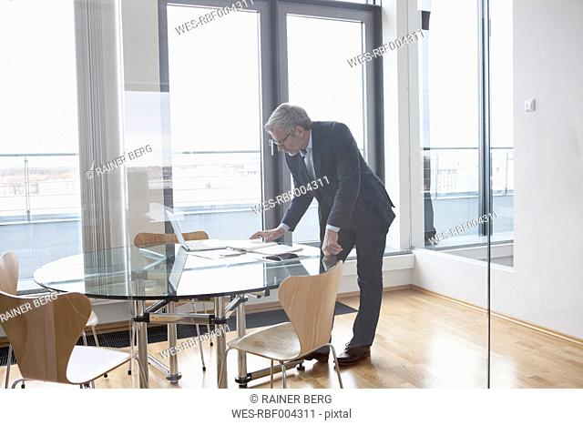 Successful businessman working in board room