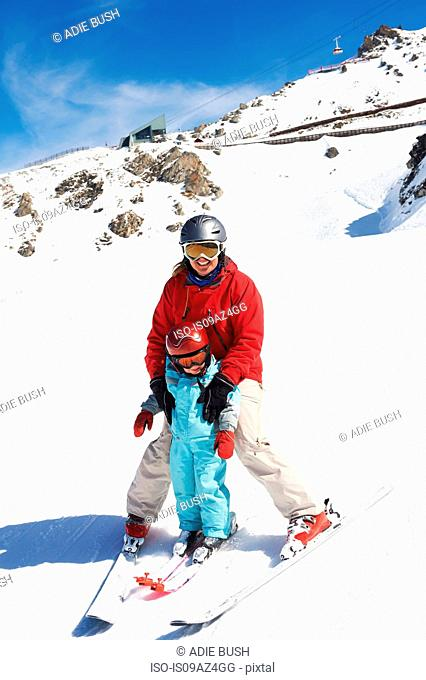 Portrait of mother and son on skis