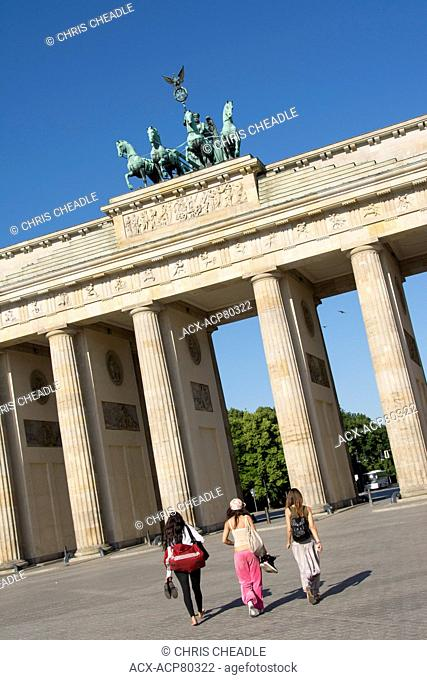 People walking to The Brandenburg Gate and Quadriga which was designed by Johann Gottfried Schadow, Berlin, Germany
