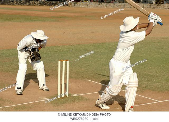 Indian batsman in action playing pull shot in cricket match MR705L