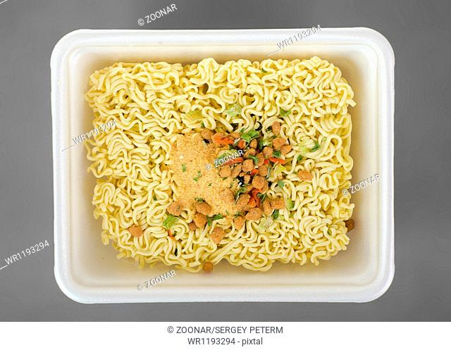Instant noodles on a gray background