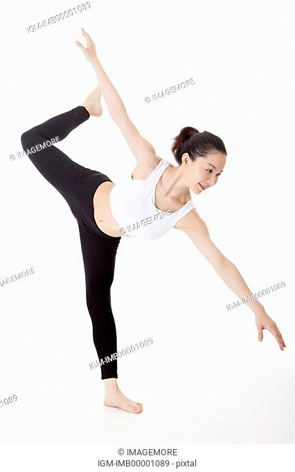 Woman practicing yoga and stretching