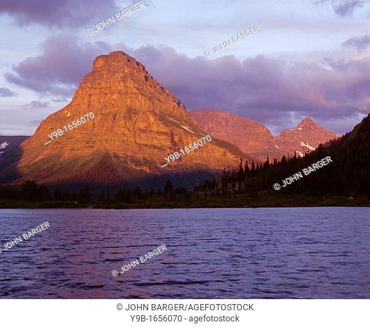 Sunrise on Sinopah Mountain above wind tossed water of Pray Lake, Glacier National Park, Montana, USA