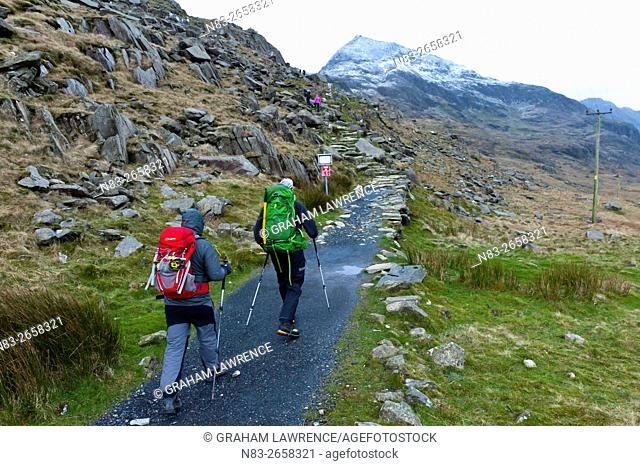 Hikers set off from Pen Y Pass in winter to climb Mount Snowdon in Snowdonia National Park, Gwynedd, Wales, UK