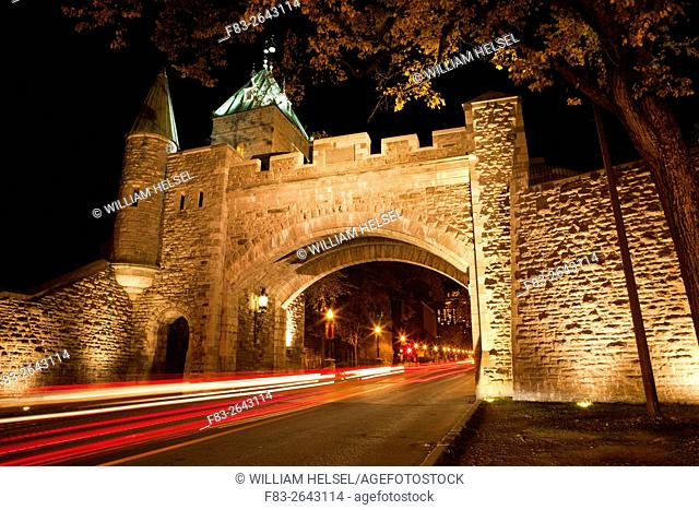 "Gate (""""Porte St-Louis"""") in old city wall, Grande Allee beyond, Quebec City, Quebec, Canada, night"
