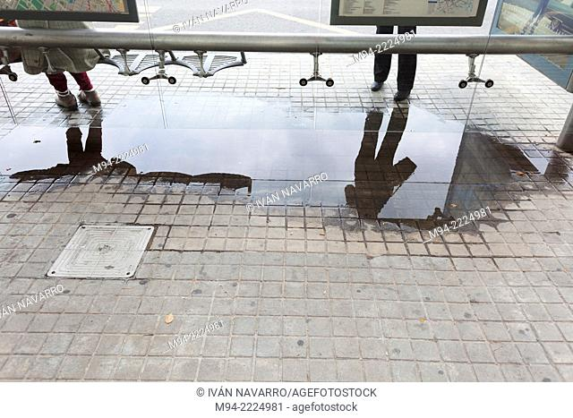 Bus station with puddle
