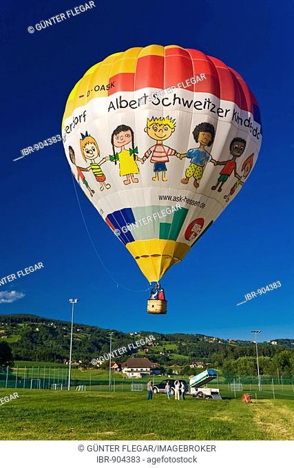 Floating hot air balloon near Stubenberg am See, Hartberg, Styria, Austria, Europe