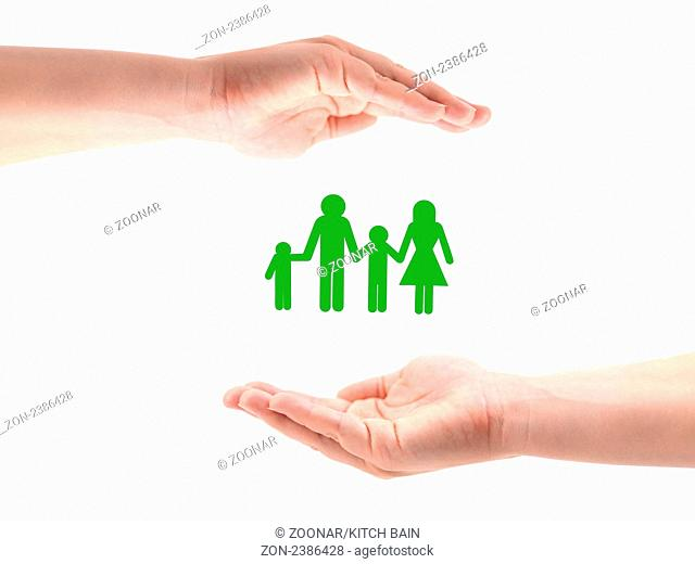Female hands around a family cutout isolated against a white background