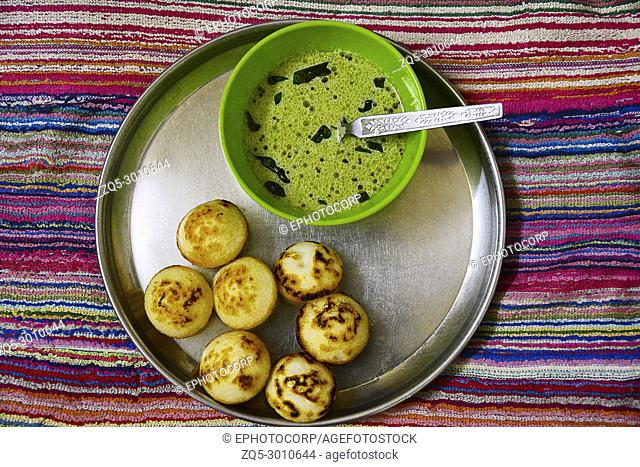 Appe is made from fermented rice and udad dal batter and shallow fried. Subtle taste added with spicy chutney made of fresh coconut and coriander leaves